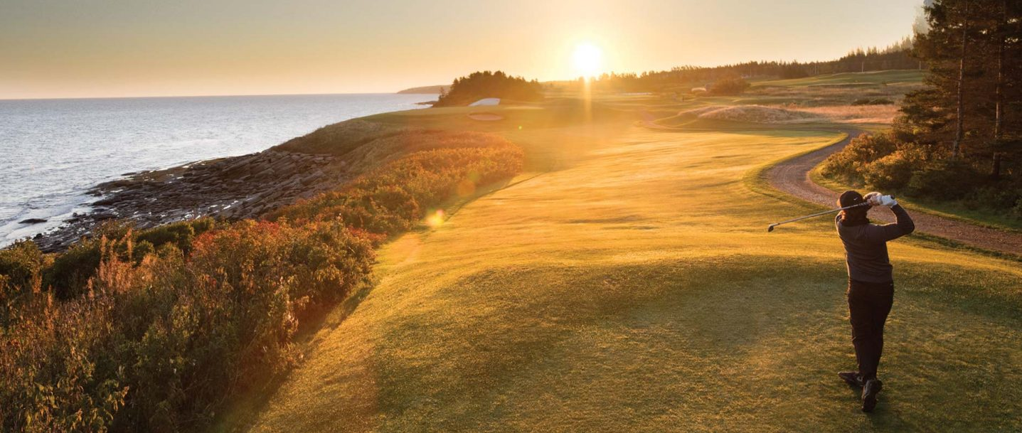 Man plays golf on a course overlooking the ocean